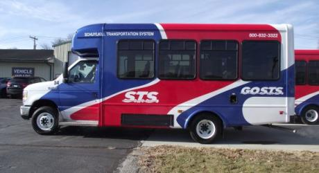 S.T.S.: designed, white vinyl installed by Coach Guard