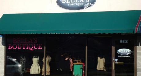 Bella's Boutique: Upper sign-printed, laminated and installed on aluminum panel sign; Door graphic- printed and laminated vinyl; Left Window- cut pink vinyl