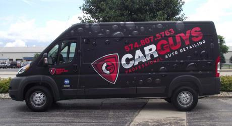 Car Guys Full Wrap: matte black wrap vinyl with printed and laminated vinyl installed by Coach Guard
