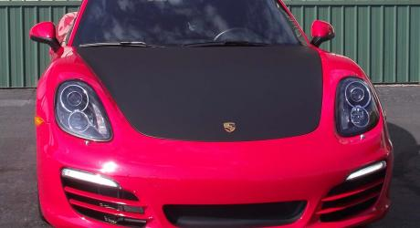 Red Porsche: black carbon fiber accent on hood installed by Coach Guard
