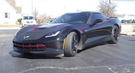 Corvette: Matte Black Hood and Roof, Dragon Fire Red Accents installed by Coach Guard