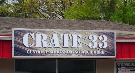 Crate 33: printed back lit material installed on back lit sign board