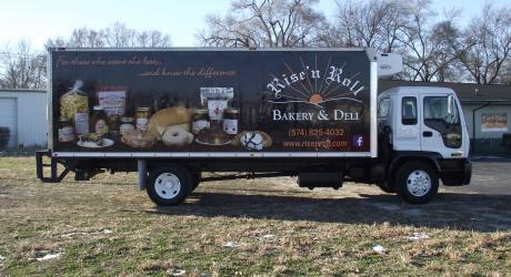 Rise N Roll box truck: printed, laminated and installed by Coach Guard.