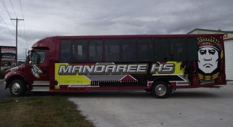 Mandaree HS Bus: Wrap installed by Coach Guard