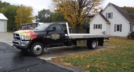 Precsion Auto Body Tow Truck:  Flame Wrap and logos designed, printed and installed by Coach Guard