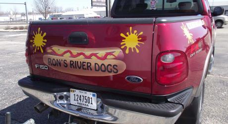 Ron's River Dogs: designed, printed, laminated and cut yellow vinyl installed